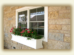Stone facade around window area with window box