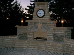 stone chimney with clock at dusk
